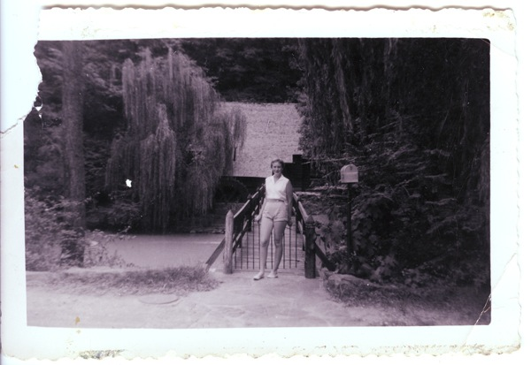 Karen, age 15, in front of mill.