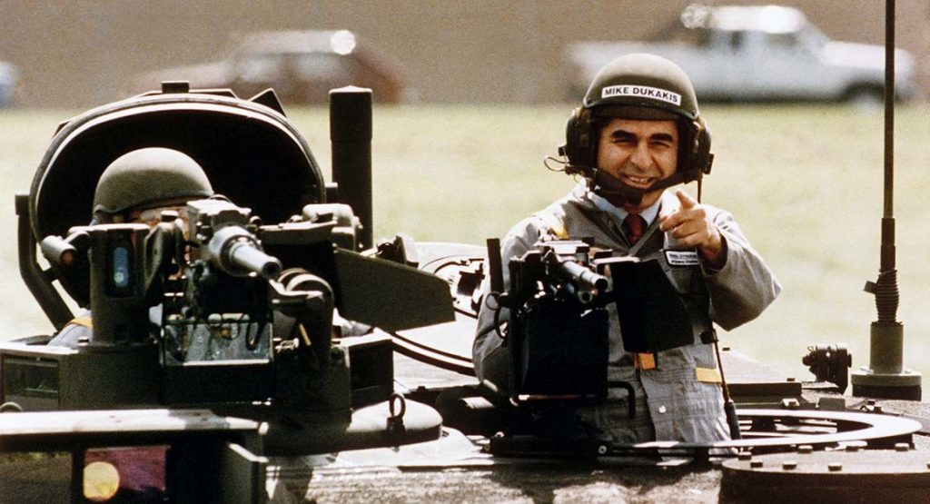 Mike Dukakis rides in Army tank